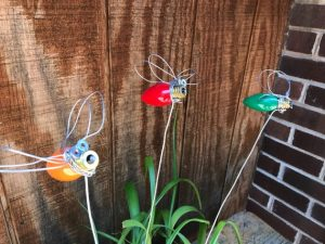 """These little guys are sweet tucked in your favorite plant. Great addition to your garden decorating A little whimsy to brighten up any pot. They are all handmade measuring 3"""" long wingspan 5"""" and about 3"""" tall on stand approximately 20"""" tall. Choose your color!"""