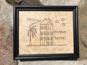"Primitive decor idea. Machine embroidered Bless This Primitive Home picture in a painted black, wooden frame, glass covered. Frame size is approximately 6 1/2 x 8 1/2"" inches and picture is 4 1/2 x 6 1/2"" inches. Great simple picture to prop up on a shelf or use in a tablescape. All items are USA made in a smoke-free home."