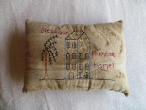 "Primitive accent pillow with saying ""Watch Over the Ones We Love"" is machine embroidered onto coffee dyed muslin. Great addition to your rustic decor. The back is black fabric. Dimensions approx. 8 x11 inches. USA made in a smoke-free home."