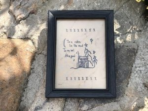 "Primitive decorating idea. Machine embroidered In a Cabin picture in a painted black, wooden frame, glass covered. Frame size is approximately 6 x 8"" inches and picture is 4.5 x 6.5"" inches. Great simple picture to prop up on a shelf or use in a rustic decor tablescape. I can also be hung on a wall. All items are USA made in a smoke-free home."