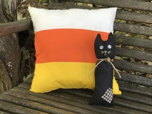 little black cat and candy corn pillow