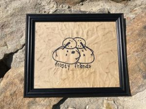 "Primitive decorating machine embroidered Frosty Friends picture in a painted black, wooden frame, glass covered. Primitive Christmas decorating idea. Frame size is approximately 9 1/2 x 11 3/4"" inches and picture is 7 1/2 x 9 1/2"" inches. Great simple picture to prop up on a shelf or use in a tablescape. It can also be hung on a wall. All items are USA made in a smoke-free home."
