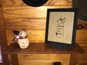 "Sweet snowman machine embroidered in a black frame. Perfect for primitive Christmas decorating! He's is a 9 3/4 x 11 3/4"" wooden frame that's been painted black. Set him on a shelf or he hang in that perfect primitive decorating space of yours. Made in the USA in a smoke free home."