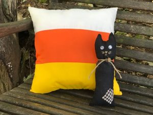 Candy cane pillow and little black cat