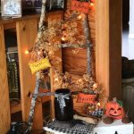 Stick ladder with fall decorations.