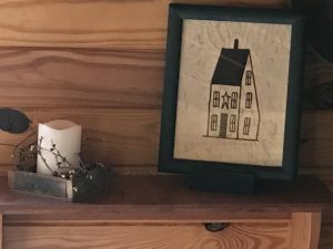 "Rustic decorating idea! Machine embroidered Saltbox House picture in a painted black, wooden frame, glass covered. Frame measures 11 1/2x9 1/2"" and the picture is 9 3/4x7 1/2"". All items are USA made in a smoke-free home."