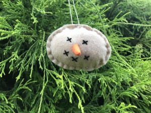 """Sleepy face primitive snowman with a long, orange nose will be a cute addition to you primitive or traditional Christmas tree. He would also be right at home on a greenery wreath completing your perfect primitive Christmas decorating ideas. Measures 3 1/2"""" x 2 1/2"""".Made in the USA in a smoke free home."""