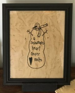 """Sweet snowman machine embroidered in a black frame. Perfect for primitive Christmas decorating! He's is a 9 3/4 x 11 3/4"""" wooden frame that's been painted black. Set him on a shelf or he hang in that perfect primitive decorating space of yours. Made in the USA in a smoke free home."""