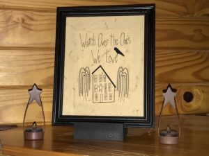 "Primitive decorating ideas. Machine embroidered Watch Over the Ones We Love picture in a painted black, wooden frame, glass covered. Frame size is approximately 11 1/2x9 1/2""inches and picture is 9 1/2x 7 1/2"".Great simple picture to hang on the wall or to prop up on a shelf or tablescape. All items are USA made in a smoke-free home."