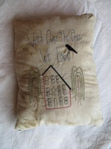 "Primitive accent pillow with saying ""Watch Over the Ones Ee Love"" is machine embroidered onto coffee dyed muslin. Great addition to your rustic decor. The back is black fabric. Dimensions approx. 8 x11 inches. USA made in a smoke-free home."