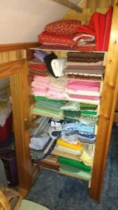 shelves full of fabric.