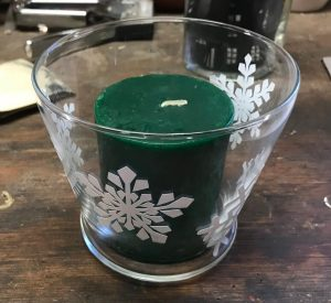 Glass candle holder with snow flakes