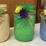 3 painted jars with flowers
